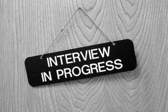 "Door sign stating: ""Interview In Progress."""